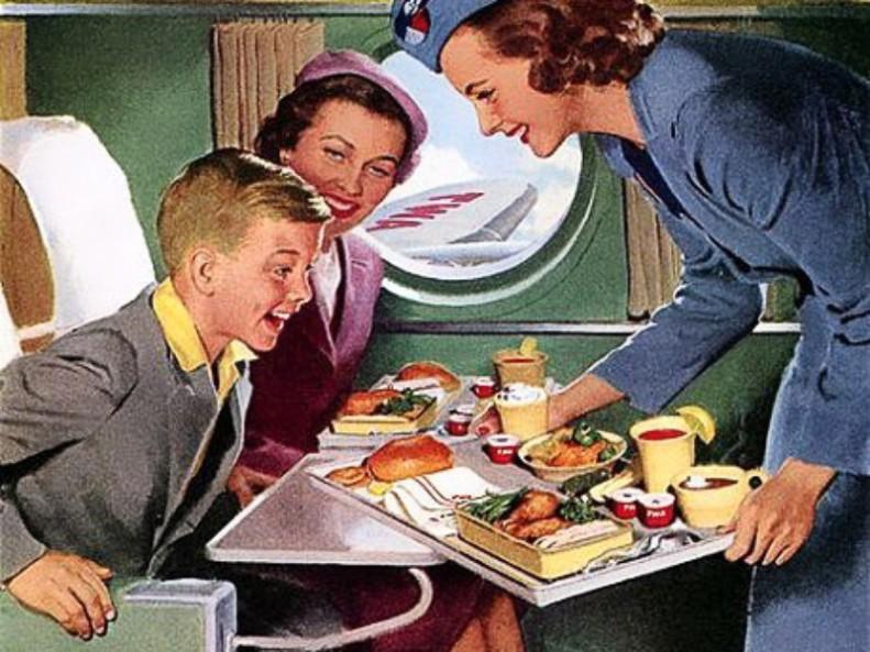 Manger un repas dans les airs durant ce vol long-courrier. photographie, photo.